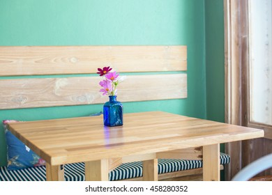 Beautiful flower in vase on the empty  table ,vintage color