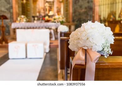 Beautiful flower wedding decoration in a church during catholic wedding ceremony