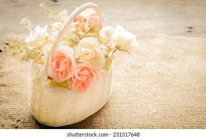 Beautiful flowers in a basket, vintage style.
