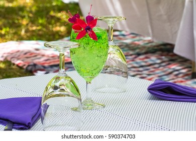 Beautiful flowers in colored clear jelly glass.