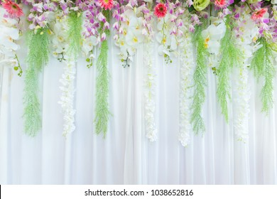 Beautiful flowers curtain backdrop background in wedding scene ceremony.