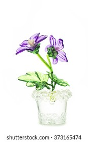 beautiful flowers in glass vase isolated on white background