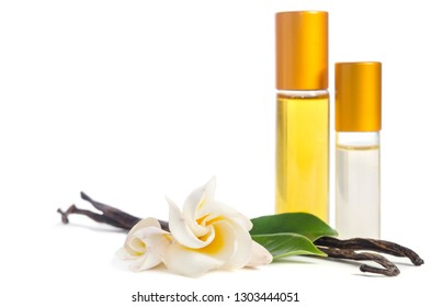 Beautiful flowers, natural vanilla  and bottles with  oils for skin isolated on white background