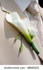 beautiful flowers on lapel of male