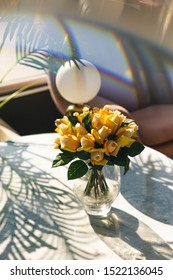 Beautiful flowers on a marble table seen though a prism