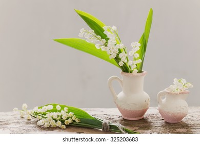 beautiful flowers on old wooden table