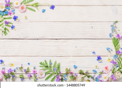 beautiful flowers on wooden background