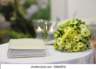 Beautiful flowers and a photo album on a white table