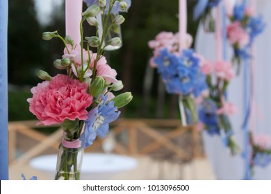 Beautiful flowers with pink and blue ribbons on the wedding day