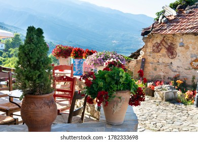 Beautiful flowers pots in old village in Old Panteleimonas, Greece