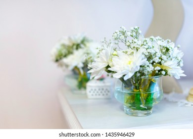 beautiful flowers, white chrysanthemums in weight on the fireplace, places for text