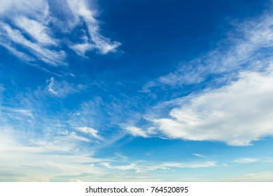 beautiful fluffy clouds in Blue sky background.