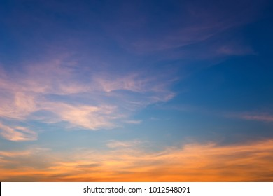 Beautiful fluffy clouds with evening sunset background.