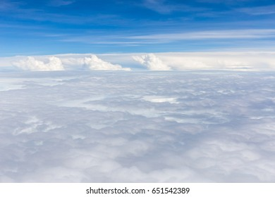Beautiful fluffy white cumulus clouds on blue sky background.