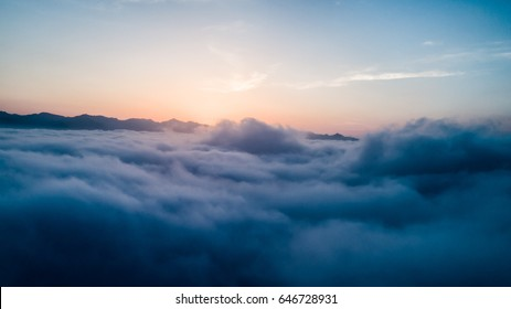 Beautiful Flying over the Clouds with the evening (morning) Sun.