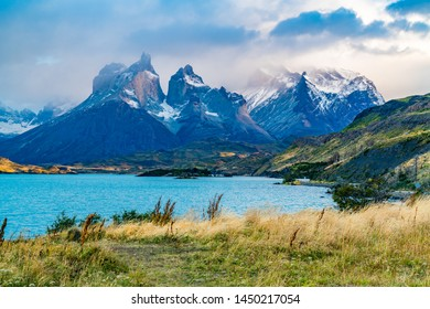 Beautiful foggy Cuernos del Paine Mountain in the evening with Lake Pehoe at Torres del Paine National Park in Chilean Patagonia, Chile