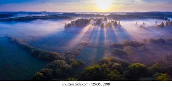 Beautiful foggy morning landscape photographed from above. Aerial landscape photographed in Poland.