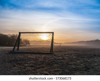 Beautiful foggy soccer pitch on a field at sunrise