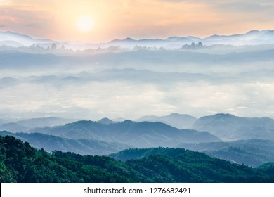 Beautiful foggy winter sunrise in mountains of north Thailand.