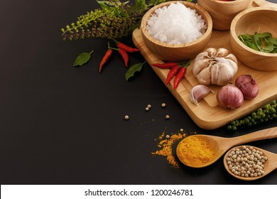 Beautiful food background - Spicy herbs on black backgound