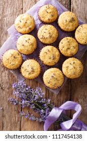 Beautiful food dessert: muffins with lavender flowers close-up on the table. Vertical top view from above
