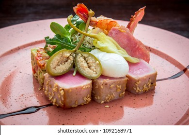 beautiful food: steak tuna in sesame, lime and fresh salad close-up on a plate on the table.