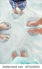 beautiful footprints with feet on the sand background