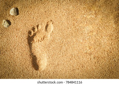 Beautiful footprints in the sand sea nature background
