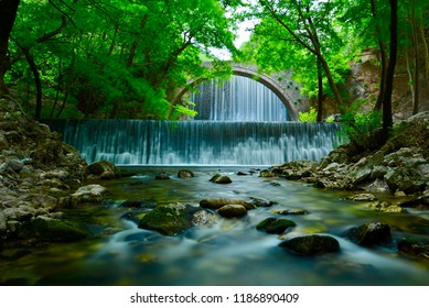 Beautiful forest landscape with reflections of trees in the water. Bosnia and Herzegovina, public park Vrelo Bosne, near Sarajevo, river Bosna