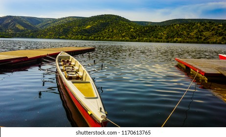 beautiful forest reflections in a lake with  a boat during beautiful day at Eymir Lake Ankara, Turkey