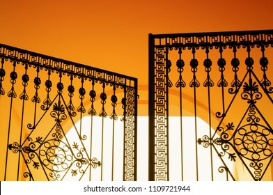 Beautiful forged gate at the entrance to the historical estate, neoclassical style