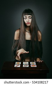 Beautiful fortune teller with tarot cards . Mistery and cartomancy