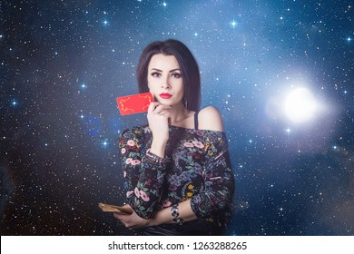beautiful fortune teller wondering on the Tarot cards. Predicting the future, access to the astral