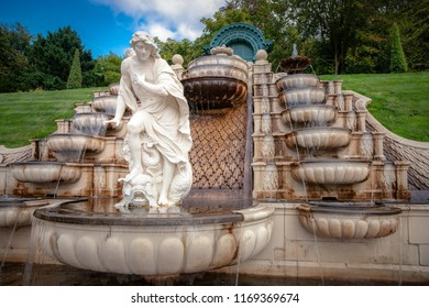 Beautiful fountain on a sunny summer day. Details from Dutch baroque garden with running water, shapes of sea shells and mythological antique white-marble statues