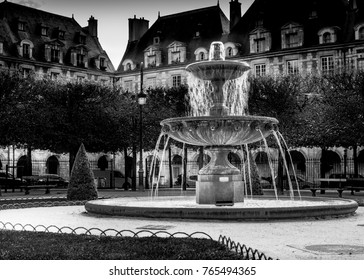 A beautiful fountain in the Place des Vosges in Paris.