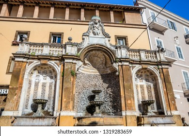 The beautiful fountain in St. Peter's Square (Piazza San Pietro), in Frascati, surmounted with the papal crossed keys. Frascati, Rome, Lazio, Italy, Roman Castles