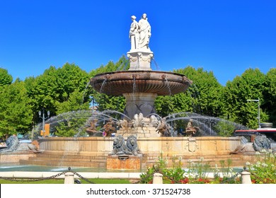 Beautiful fountain in sunny square surrounded by trees, Aix en Provence, Languedoc Roussillon, France