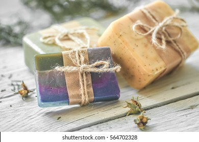 beautiful, fragrant handmade soap lies on a circular base on a wooden background