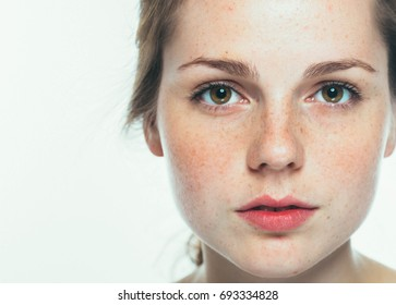 Beautiful freckled face woman close up, healthy skin beauty girl model.