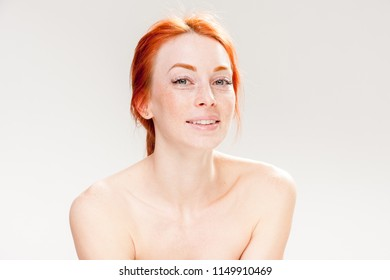 Beautiful freckled redhead woman smiling