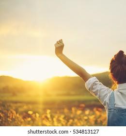 Beautiful freedom girl in sunset