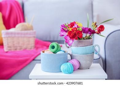 Beautiful freesia flowers on table in room