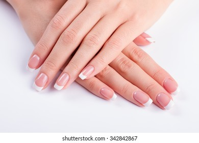 Beautiful french manicure. Neat female hands.