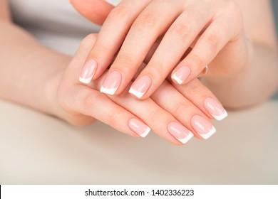 Beautiful french manicured female hand
