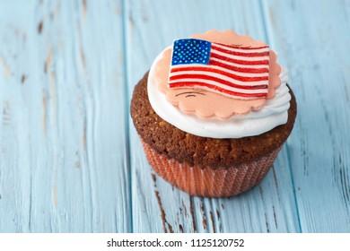 Beautiful fresh American Capcake on a Blue Table