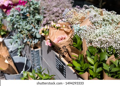 Beautiful fresh blossoming flowers texture at the florist shop. Gypsophilia, roses, eucalyptus for sale