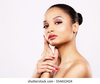 beautiful fresh face with light makeup and pink lipstick on white background