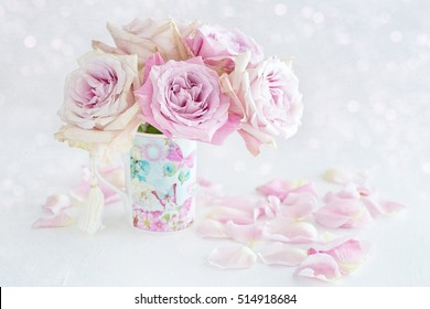 Beautiful fresh pink roses in a beautiful  porcelain cup on a light background .