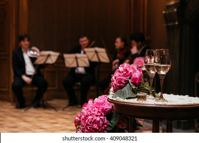 Beautiful fresh purple flowers & champagne glasses at wedding ceremony aisle closeup