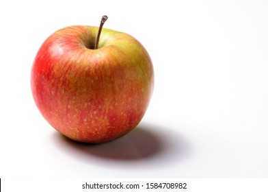 Beautiful fresh red apple on white background with drop shadow. Copy space.